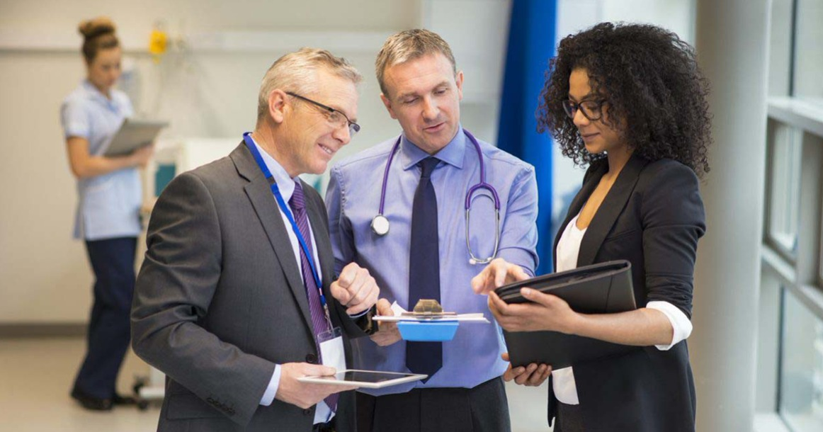 3 healthcare professionals conversing